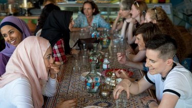 Aseel Tayah (left in pink) and Madelaine Imber (right) at the  Speed Date a Muslim event at the Moroccan Deli-Cacy in Lygon Street, East Brunswick.