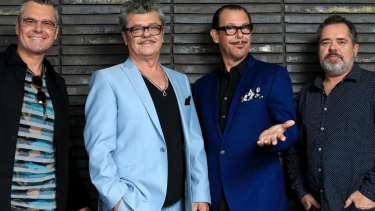 Kirk Pengilly with INXS band members.