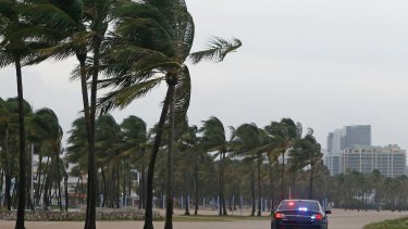 Miami Beach Police patrol Miami Beach as storm closes in.