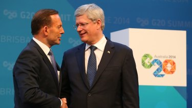 """Allies: Australian Prime Minister Tony Abbott, left, and Canadian Prime Minister Stephen Harper shake hands. At the G20 summit, the Canadian leader bluntly told Russian President Vladimir  Putin to """"get out of Ukraine""""."""