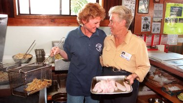 Pauline Hanson cooking up fish and chips with One Nation candidate Robin Innes.