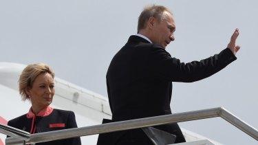 Final wave: Vladimir Putin leaves Brisbane after the G20 summit.