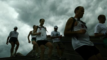 Sir Ranulph Fiennes (third left) during his successful bid to run seven marathons in seven continents in seven days.