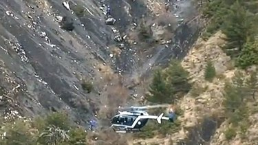 Reassurance sought: A rescue helicopter from the French Gendarmerie hovers in front of the crash site of an Airbus A320, near Seyne-les-Alpes. All 150 people on board died.
