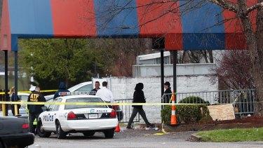 Police investigate the crime scene at the Cameo club.