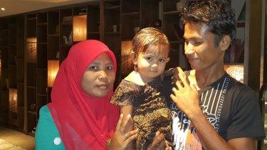 Ali Jasmin with his wife Baualan and his 18-month-old daughter Aisah Nuruna.