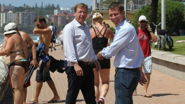 Premier Mike Baird, right, and Deputy Premier, Troy Grant, at Queenscliff beach on Sunday.