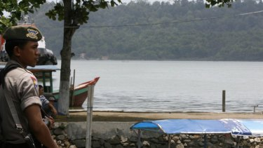 A policeman guards a harbour in Cilacap in Central Java near Nusakambangan prison island in 2008.