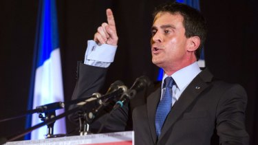 Lights out: French Prime Minister Manuel Valls gestures as he speaks during a meeting in Audincourt.