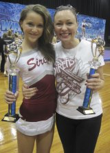 Leanne Shea Langdown with daughter Tahlia at a cheerleading competition. Photo supplied.