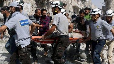 Emergency workers   in al-Sakhour, a  rebel-held part of eastern Aleppo.