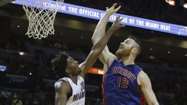 Optimistic for Rio: Aron Baynes goes up against Miami Heat's Justise Winslow last week .