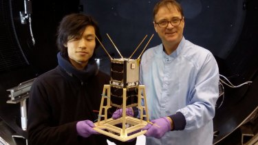 Professor Iver Cairns (right) and PhD student Jiro Funamoto with the CubeSats to be launched from the International Space Station early next year.
