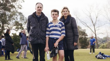 Joe Meagher, 12, with parents Dr Elizabeth Meagher and Alan Meagher at Riverview College.