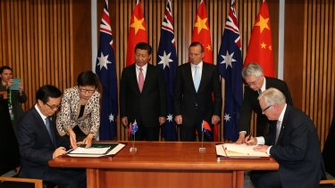Chinese President Xi Jinping (rear) and then Australian prime minister Tony Abbott witness the signing of the declaration of intent on the Australia-China Free Trade Agreement late last year.