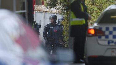 Police in riot gear outside the Parkville Youth Justice Centre on Monday.