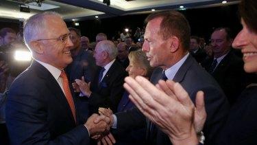 Mr Turnbull greets Mr Abbott before the launch.