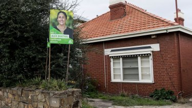 A Greens placard has been erected by tenants of Labor MP David Feeney's investment property in Northcote, urging locals in the Melbourne seat of Batman to vote for Greens candidate Alex Bhathal