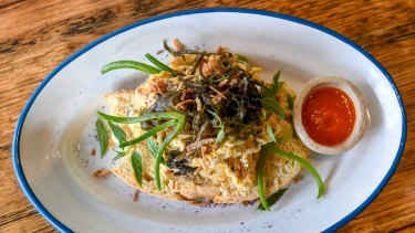Seaweed scrambled eggs with manchego, crispy shallots and macadamia sriracha.