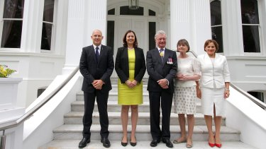 Premier Annastacia Palaszczuk on the front steps of Government House with Treasurer Curtis Pitt, Governor Paul de Jersey and his wife Kaye de Jersey and Deputy Premier Jackie Trad following the swearing-in ceremony.