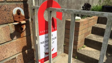 Advertising materials hung on gates and doors are illegal under NSW's litter laws.