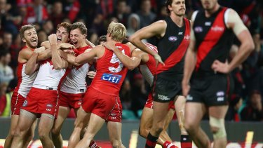 Gary Rohan celebrates with team mates after kicking a goal to win the match during the round 14 AFL match between the Sydney Swans and the Essendon Bombers.