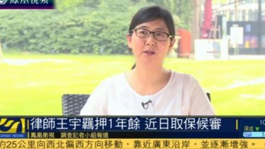 Human rights lawyer Wang Yu being interviewed on Hong Kong-based Phoenix TV after her release on bail.