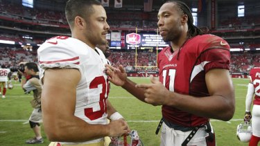 Getting some tips: Cardinals wide receiver Larry Fitzgerald talks with Jarryd Hayne after the game.