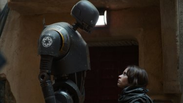 Robot K-2SO (left, with Felicity Jones as Jyn Erso) is the undisputed star in the latest Star Wards installment. A sign of things to come?