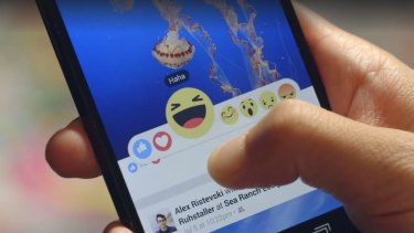 """A beta version of Facebook's new emoticons showing the """"yay"""" button, which has since been dropped."""