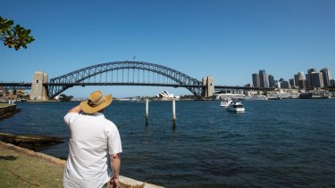 A tourist takes in the view from Blues Point Reserve.