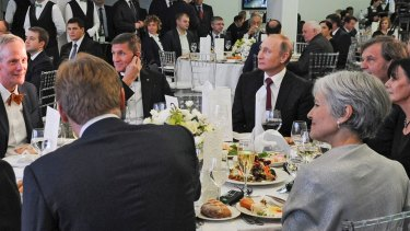 Michael Flynn (centre left) next to President Vladimir Putin at an event celebrating RT in Moscow. Jill Stein, 2016 US Greens candidate, is seen with her back to camera.