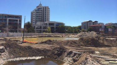 "Perth's new lakes district? Excess water from the Aurelia site is being pumped here to the site across the road, but the City of South Perth says it is the ""apparent"" cause of flooding at the neighbouring apartment block."