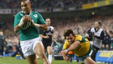 Flying start: Ireland winger Simon Zebo swoops on a kick to score the opening try.