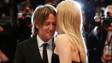 Nicole Kidman shares an intimate moment with her husband Keith Urban on the Cannes red carpet.