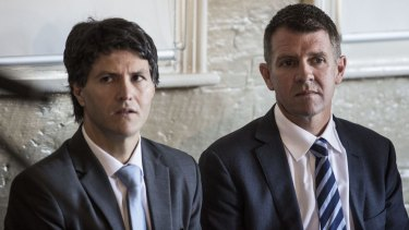 Minister for Citizenship Victor Dominello (left), pictured with NSW Premier Mike Baird, forced the head of Multicultural NSW to withdraw divisive guidelines regarding public memorials.