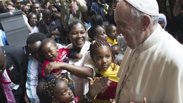 Pope Francis meets children during his visit to Kangemi, one of the 11 slums dotting Nairobi.