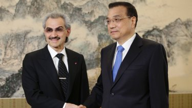 Saudi Prince Alwaleed bin Talal, left, shakes hands with China's Premier Li Keqiang. The prince was once of 11 arrested along with ten former ministers.