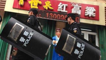 Chinese police patrol a street in Urumqi, the capital of Xinjiang region.