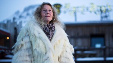Mary-Ann Dahle, one of the colourful residents of Svalbard in Norway, sports her  polar bear coat.