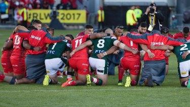 Unity: Tonga and Lebanon players share a prayer after Tonga's victory.