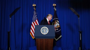 US president Donald Trump walks from the podium after announcing his military's air strikes against Syria.