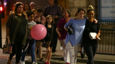 Concertgoers leave the Manchester Arena following the deadly explosion.