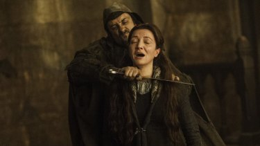 Catelyn Stark dying at the Red Wedding thanks to the treacherous Freys.