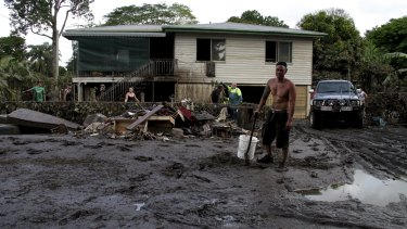 Resident Paulo Balbarais is joined by friends and family to start the clean up on Lower William Street, Goodna.