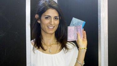 Virginia Raggi casts her ballot in Rome.