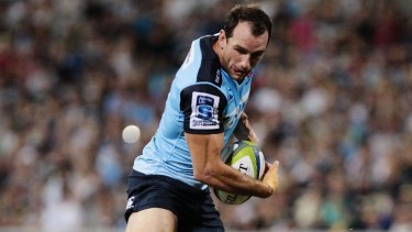 Busy boy: Matt Carraro is tackled during the round two NRL match between the Brumbies and the Waratahs at GIO Stadium.