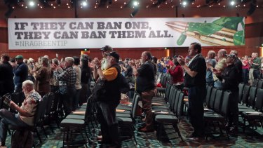 National Rifle Association members applaud during their annual meeting, held in Nashville in April.