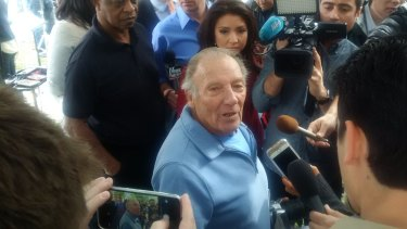 Frenzy ... Landlord Doyle Miller stands in the middle of a media scrum after opening up his apartment to reporters.