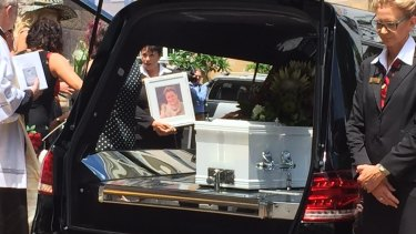 Lloyd's casket leaves her funeral.